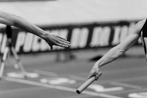 relay-race-racing-hands-men-runners-KL4T