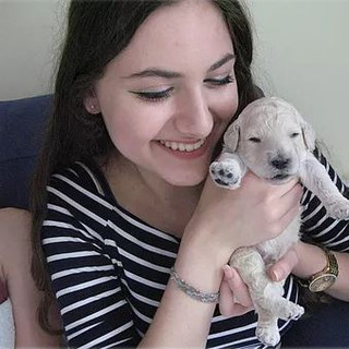 girl with poodle puppy.JPG