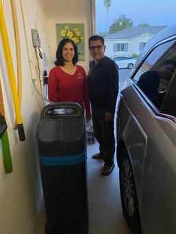 Happy couple with new water softener
