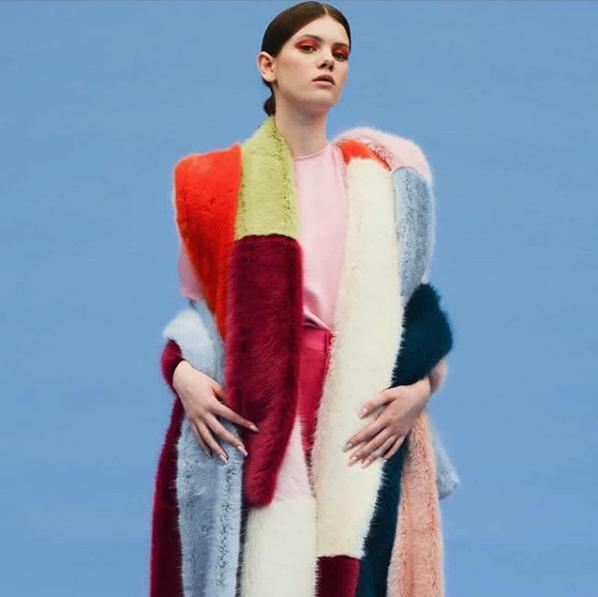 girl wearing lots of faux fur scarfs