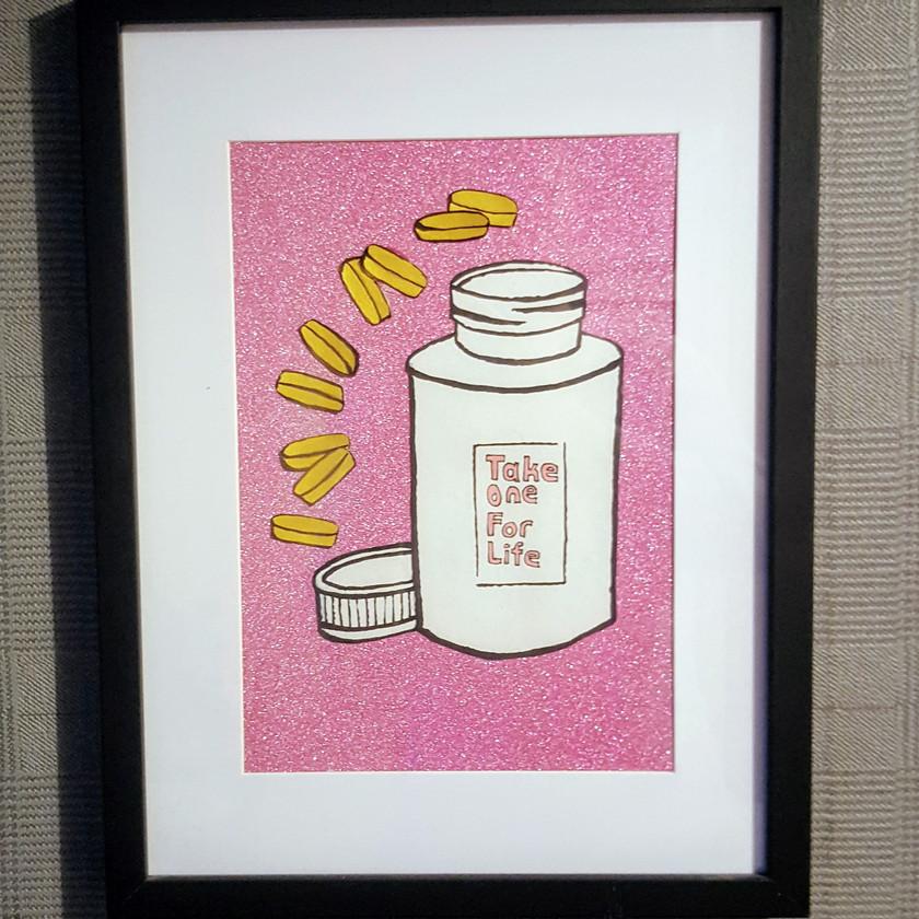 Pill bottle and pink glitter