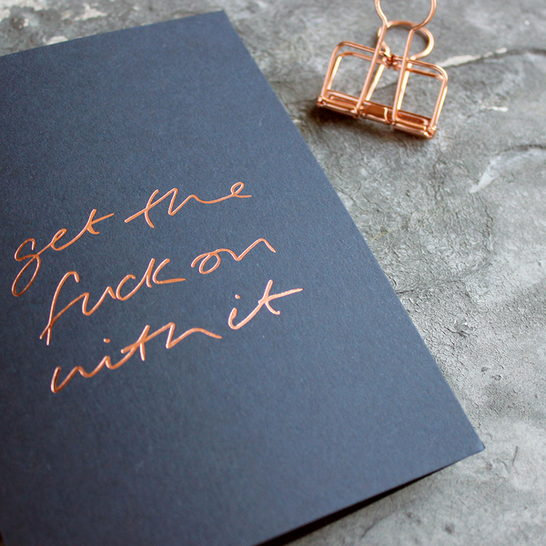 card with gold writing