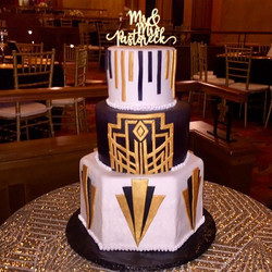 Gold and black tier wedding cake