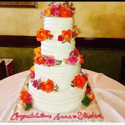 4 tier fresh flowers wedding cake