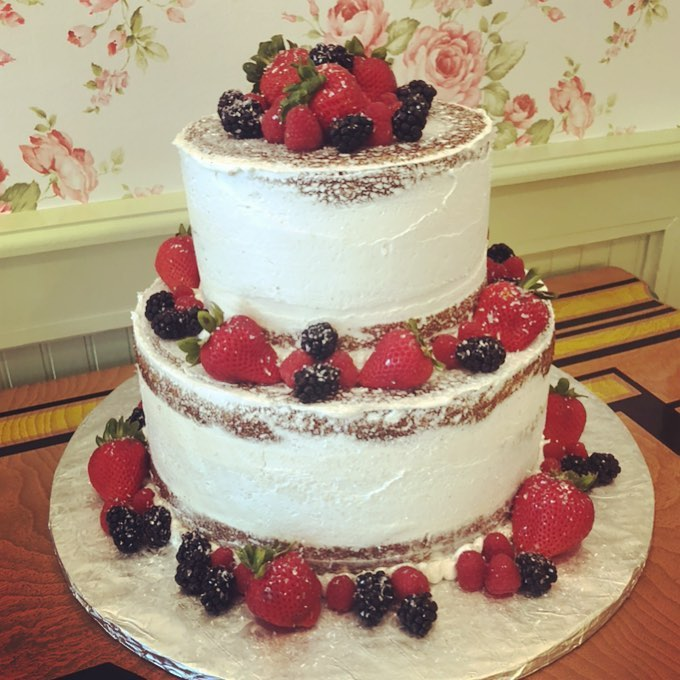 Naked 2 tier cake with fresh berries