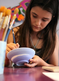 girl painting pottery.jpg