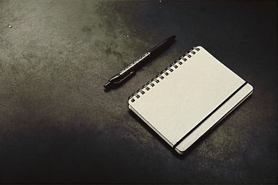 black click pen beside notebook_edited.j