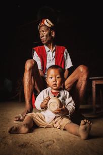 Konyak Tribe: Greatgrandfather with Greatgrandson. Nagaland, India 2017
