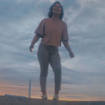 Happy Girl standing in Sunset