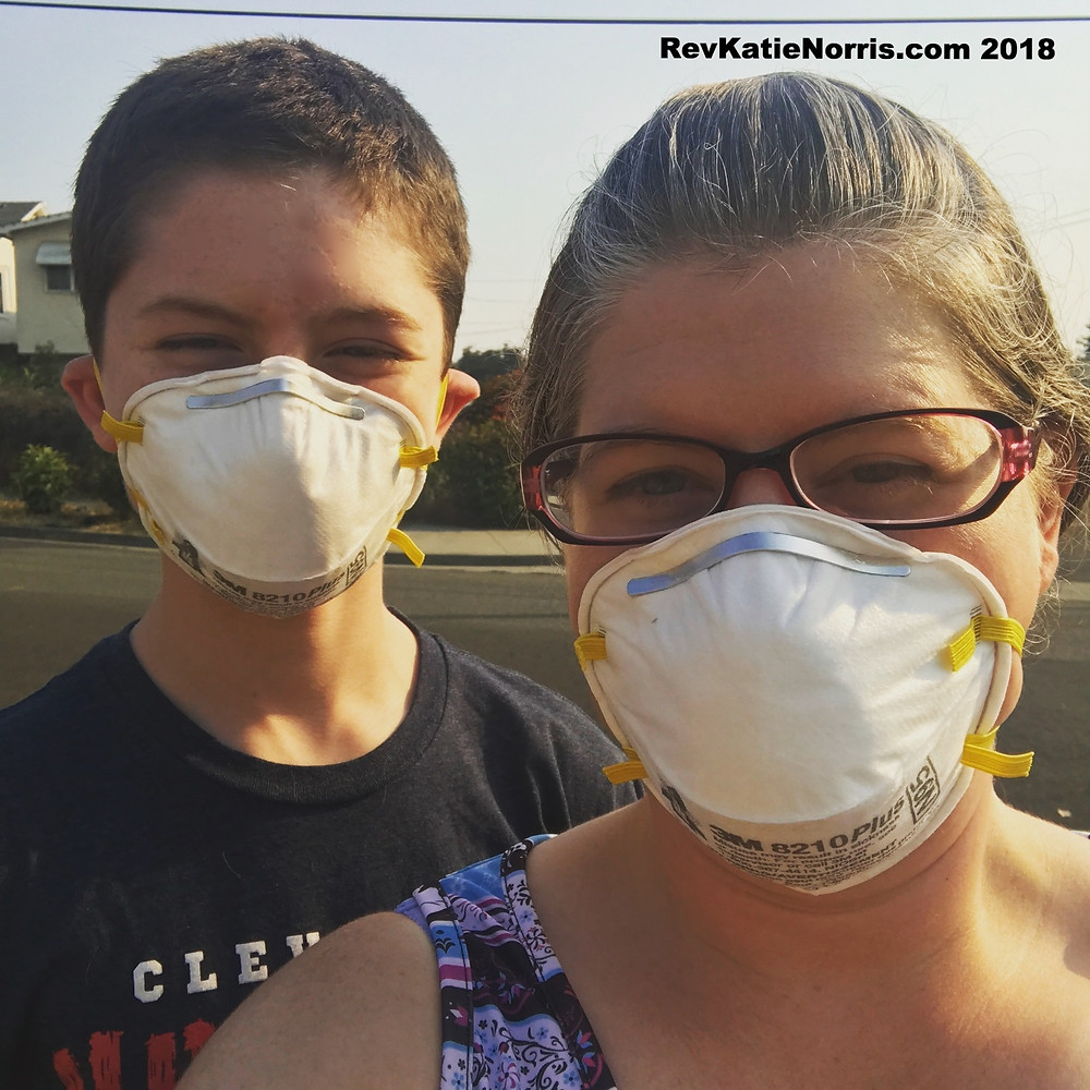 Wearing masks to protect from the California fires. Please note that I am wearing the mask wrong. You must put the top strap above your ears. Children of a certain size need smaller masks, link below.