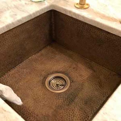 Square hammered copper sink for kitchen prep.
