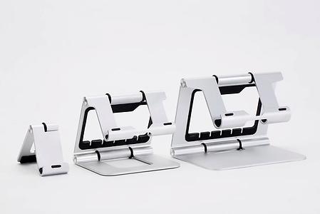 der ridge stand ist ein ständer, der hauptsächlich für apple-produkte entwickelt wurde. er gewährleistet eine bessere körperhaltung, da es den display erhöht und nicht dazu zwingt, sich nach unten zu beugen. mit einem bildschirm auf augenhöhe, einer externen maus und tastatur verbessert sich die körperhaltung zusehens. dann fällt es auch nicht mehr so schwer, das gerät länger an einem stück zu verwenden. er gibt je eine version für laptops, smartphones und tablets.