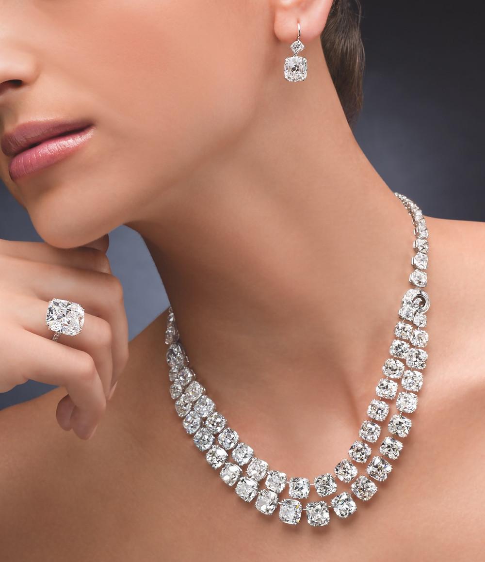 Double Row Antique Cushion Cut Diamond Necklace, 119.03 carats. 14.28 carat Cushion Cut Diamond Ring with 10.20 carat Cushion Cut Diamond Earrings.