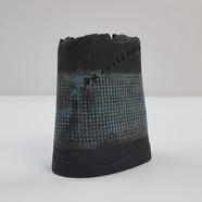 Black clay wth engobe resist surface decoration