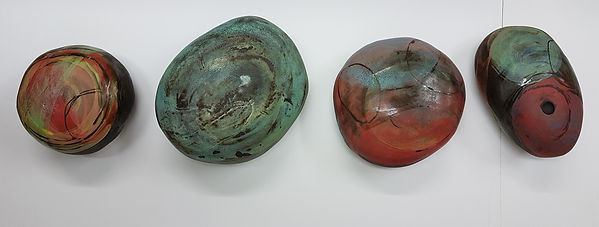 Colourful Black clay enclosed forms sgraffito,engobes