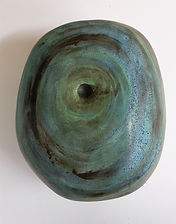 Colourful ceramic enclosed form sculpture, black clay hand built,sgraffito,engobe,