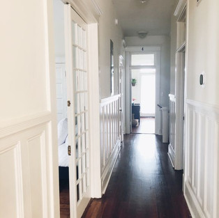 Hallway from bedrooms to kitchen and living area