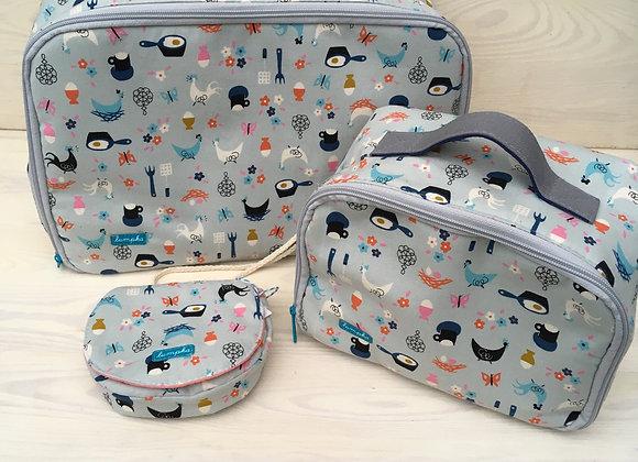 Sada dvou kufrů a kabelky