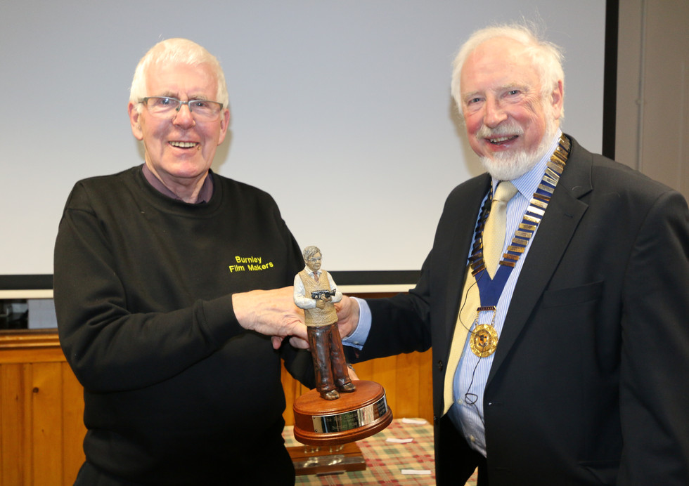 David Crossley recieves the trophy for Best Editing from Chairman Mike Breeze