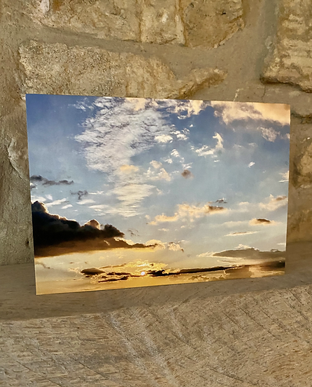 A card showing a photograph of the sky over Minchinhampton Common