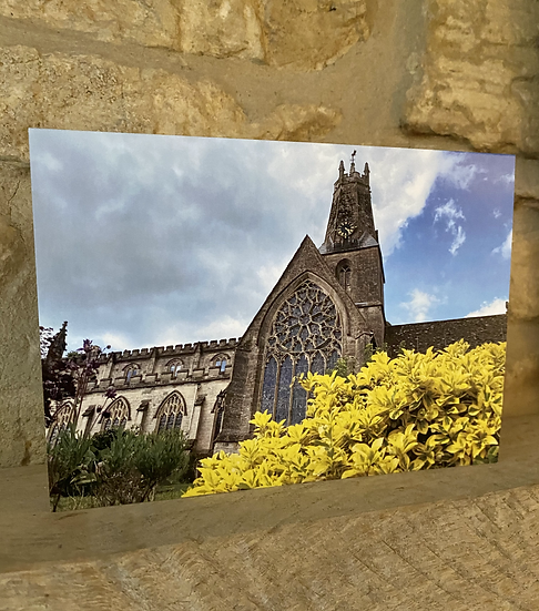 A card showing the exterior of Holy Trinity Church in Minchinhampton