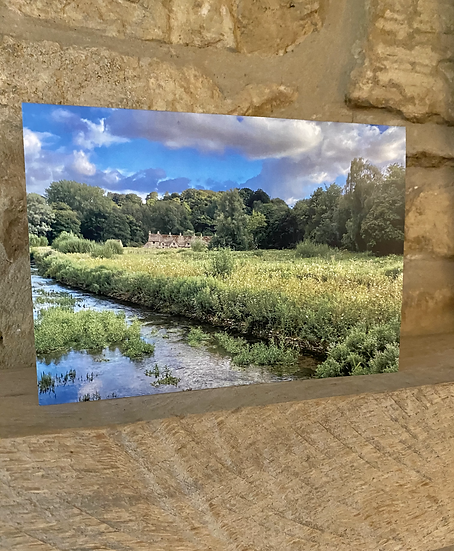 A card showing a view of Arlington Row in Bibury.