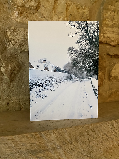 A card showing Quiet Lane in Burleigh covered in snow