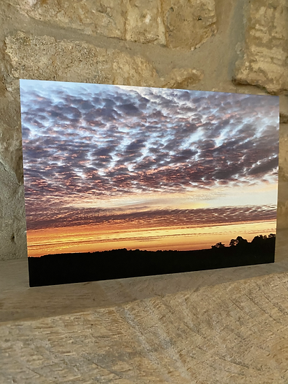 A card showing an image of the sky during sunset over Rodborough Common