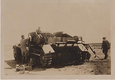"Arthur wrote - ""this is the type of tank we were up against in Tobruk, the boys are disassembling it "" one of Rommel's panzers"