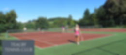 Some people enjoying the tennis courts at Tealby Tennis & Bowls Club, Tealby