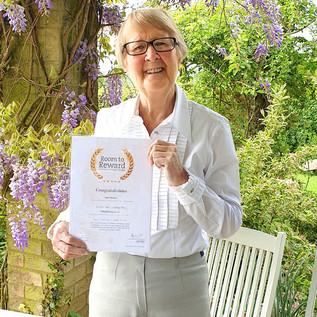 Bess Scott Gunn receives an award from St.Barnabas Hospice Trust