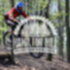 A rider jumping through the Freeride Park in Willingham Woods near Tealby