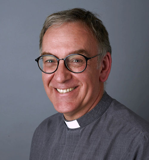 A photograph of Reverend Christopher Hewitt