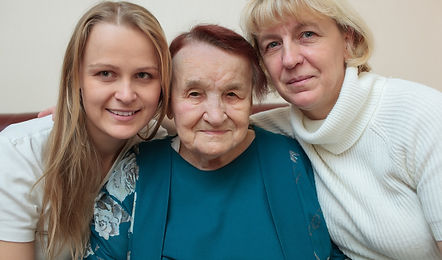 Grandaughter, mother, and grandmother illustrate an article about caregiving for seniors and their children