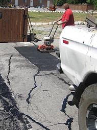 Utah County Seal Coat and Striping Asphalt repair parking lot orem provo crack seal patching pothole repair
