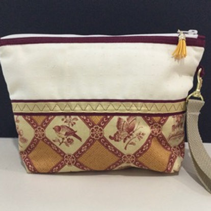 Large Wristlet- creme; pale yellow, rusty red floral