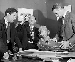 John Read, Gerry Anderson, Sylvia Anderson, and Reg Hill admire Stingray