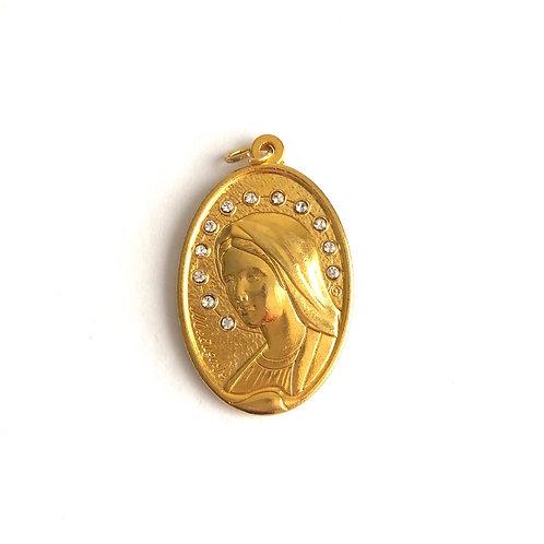 J042 Medalla Virgen Medjegourge Dorada con piedras Blancas