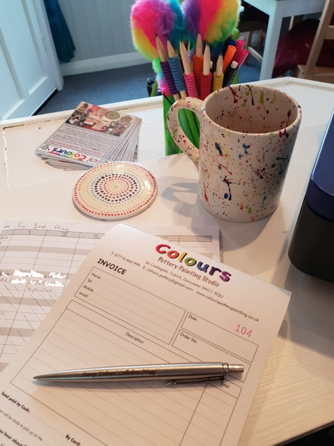 Pen Cup and invoices.png