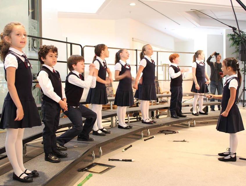 Arden Reno conducts Junior Chorus