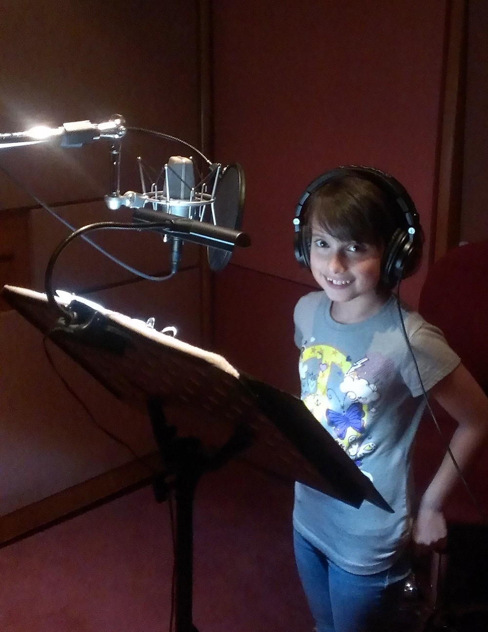 "Natalie Shtangrud in the studio, recording the songs for the animated series ""Masha and the Bear"""