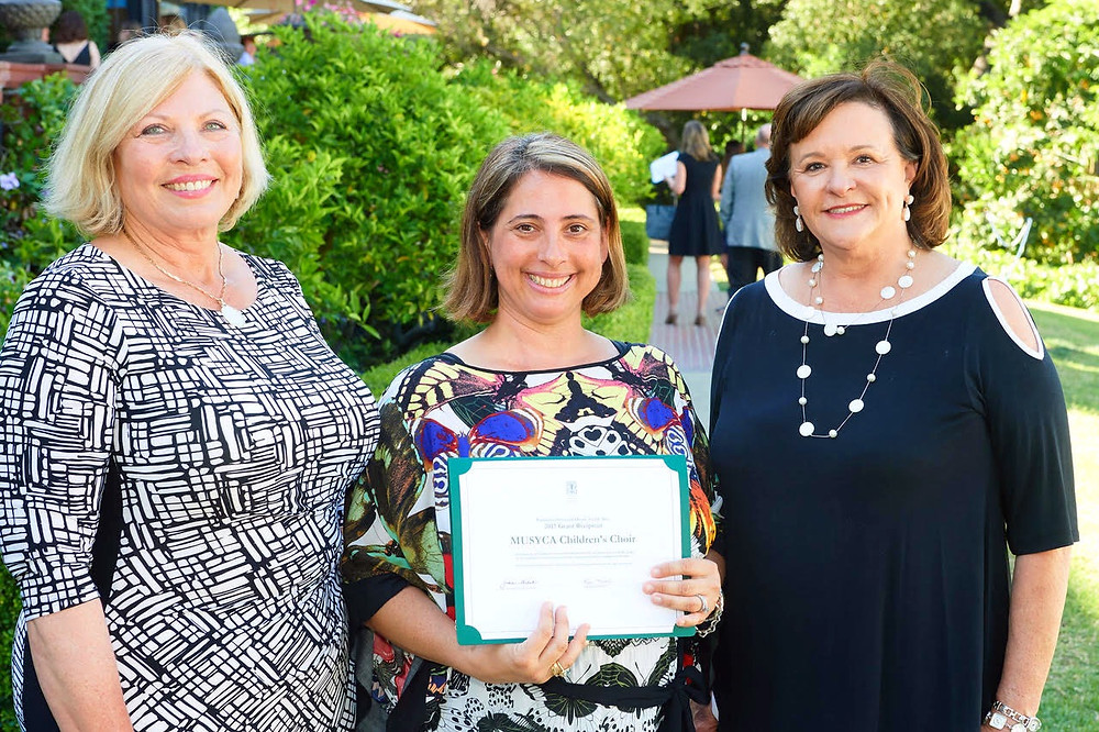 MUSYCA's Executive Director Dr. Anna Krendel, accepting the award with (L-R), Marilyn Anderson, incomingPSHA President and Lynn Mehl, current PSHA President