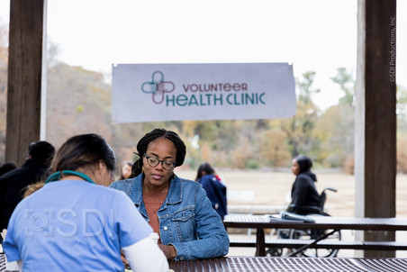 Doctor Documents Patient Information at Free Clinic