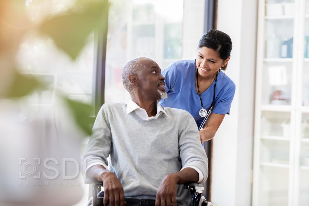 Senior Man in Wheelchair Receives Medical Help