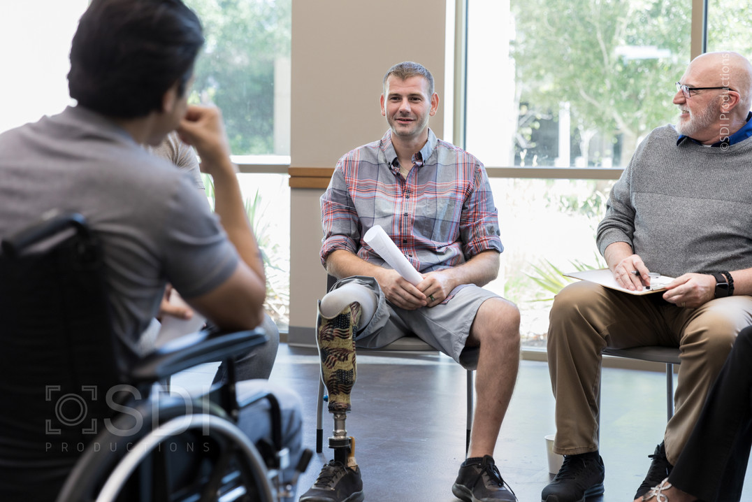 Injured Veterans Talk with Each Other During Meeting