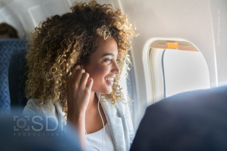Woman Listens to Music During Flight