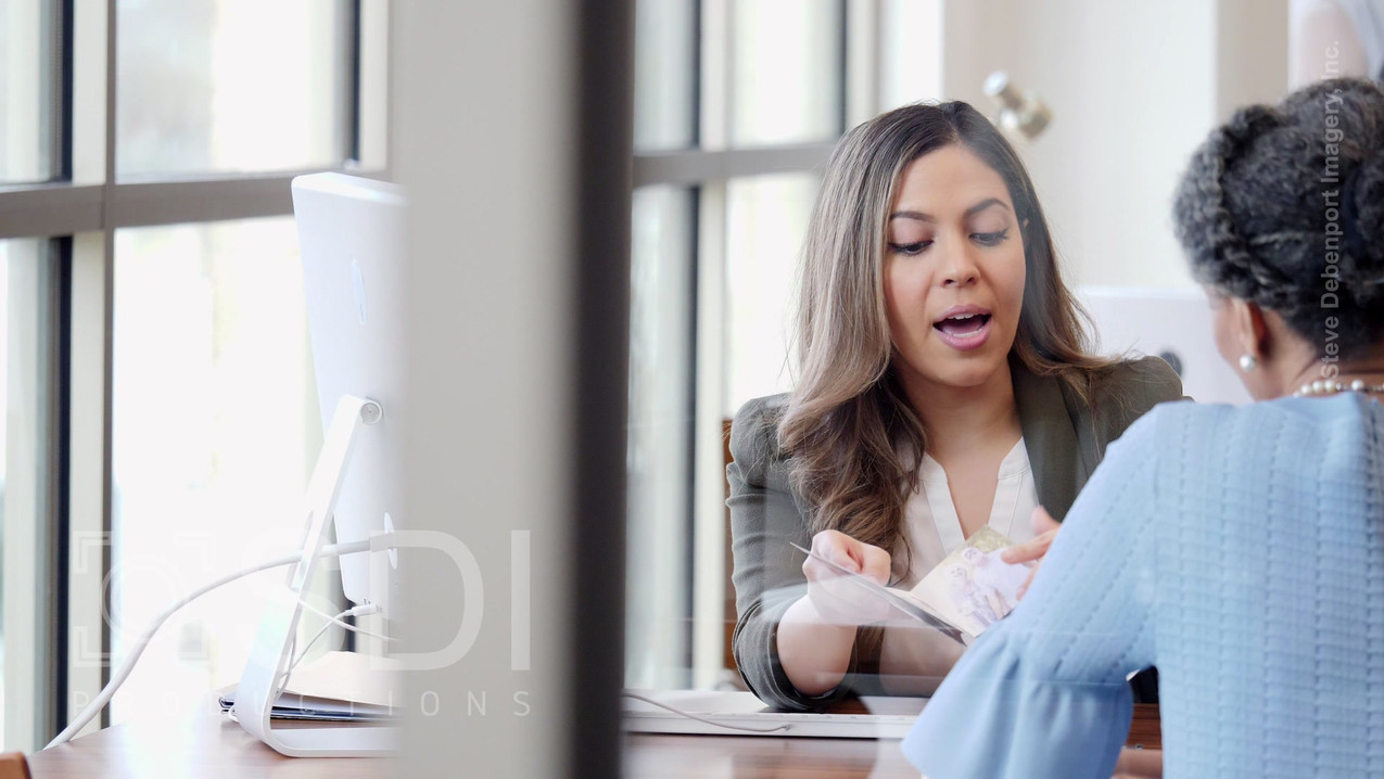 Bank Employee Discusses New Account with Customer