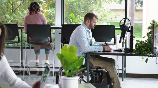 Diverse Businesspeople Working in Open Office Concept