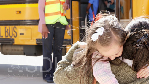 Excited Girl Greets Her Mom with a Hug After School