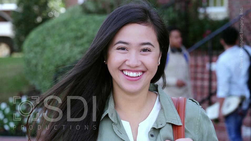 Confident Female Asian College Student Smiling